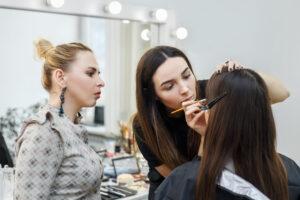 makeup instructor teaching student